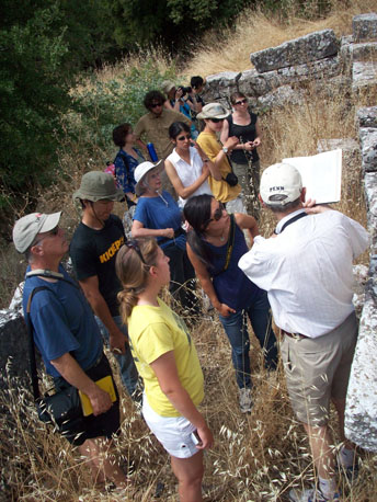 David Romano shows the group a reconstruction of the fountain house at Lykosoura