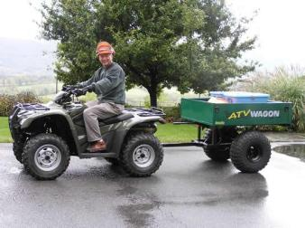 Blake Gall with his ATV and trailer ready to haul supplies up the Mountain