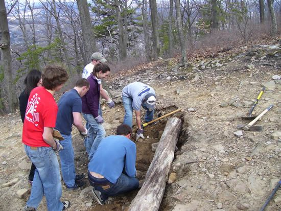 Replacing a water bar at the Lynch Overlook.