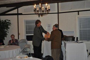 John Hook, MNC President, presents Tom Smyth his Friend of the Mountain award