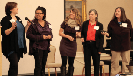 """Brandy Sullivan and Jennifer Buddin were at the Center's Annual Women's Conference in February. The """"AM Energizer"""" featured """"Hot Pants"""" from Theatre 99."""