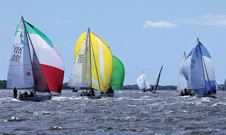 Sperry Charleston Race Week 2017, colorful keelboats in Charleston Harbor