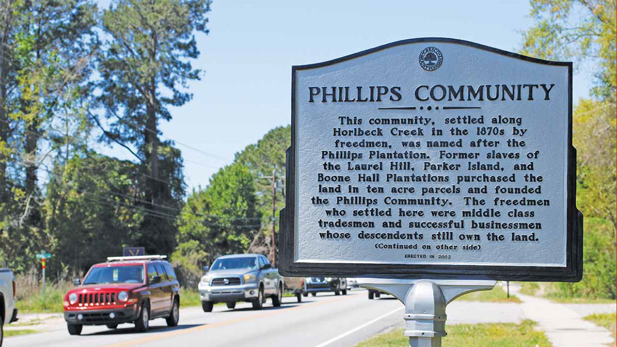 Mount Pleasant, SC sign on Hwy 41 reads: This community, settled along Horlbeck Creek in the 1870s by freedmen, was named after the Phillips Plantation. Former slaves of the Laurel Hill, Parker Island, and Boone Hall Plantations purchased the land in ten acre parcels and younded the Phillips Community. The freedmen who settled here were middle class tradesmen and successful businessmen whose descendants still own the land. (Continued on the other side) Erected in 2002