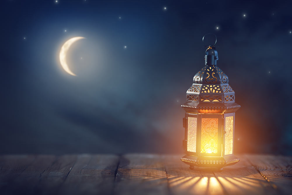 A lantern provides light against the dark sky.
