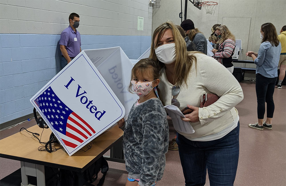 Kristie Rasheed took her daughter Stella to observe her mother and father perform their civic duty as they voted.