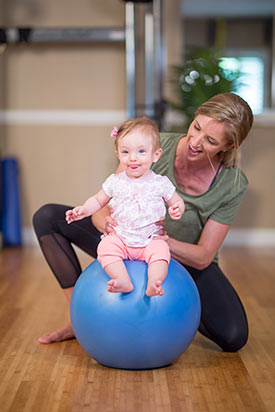 Jill Zimmerman with her daughter playing and moving.