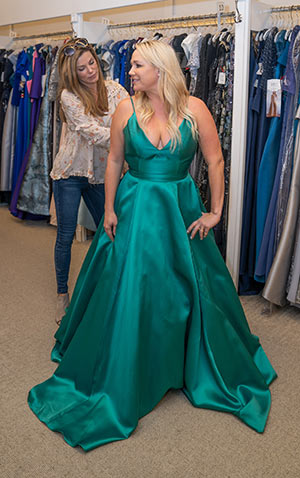 Trying on a dress at Jean's Bridal Charleston on Johnnie Dodds Blvd in Mount Pleasant, SC