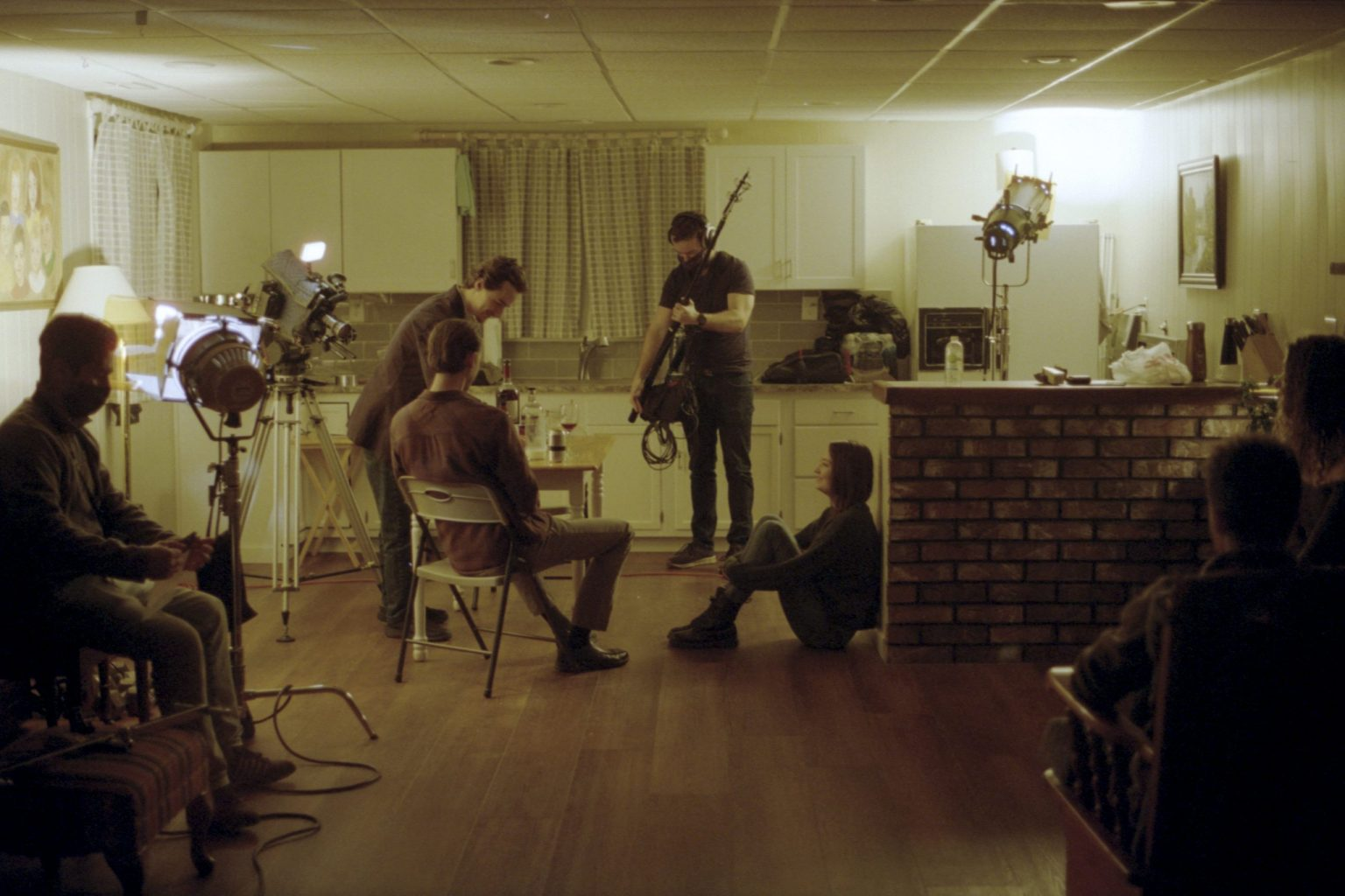 A wide image of the cast and crew working on the set of A Moment Is Enough.