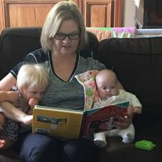 Grandma Hyneman reading a story to Milli and Charli.