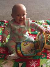 Milli playing with a musical book