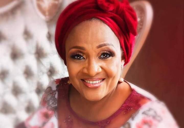 Hon. Faozey congratulates Florence Ajimobi at 62
