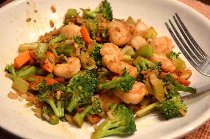 "Paleo Coconut Curried Shrimp Over Stir-fried ""Rice"""