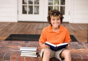 Boy reading on porch