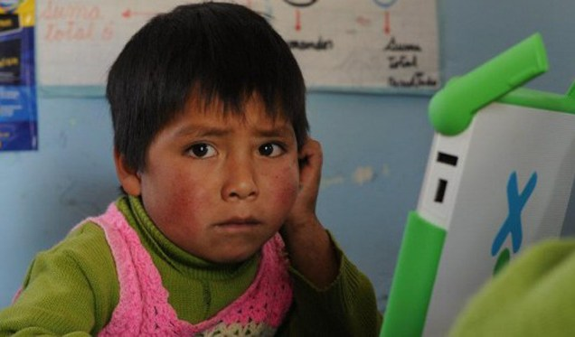 """Child in Peru looks at a laptop in Michael Kleiman's """"Web"""""""