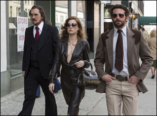 "Christian Bale, Amy Adams and Bradley Cooper in ""American Hustle"""