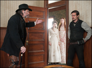 "John Travolta, James Ransone, Karen Gillan and Taissa Farmiga in ""In a Valley of Violence"""