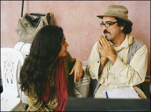 "Golshifteh Farahani and Atiq Rahimi on the set of ""The Patience Stone"""