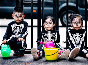 "Children celebrating Dia De Los Muertos in ""Que Caramba Es La Vida"""