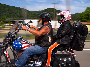 "Ron Hall and wife Alicia on a motorcycle in Debra Granik's ""Stray Dog"""