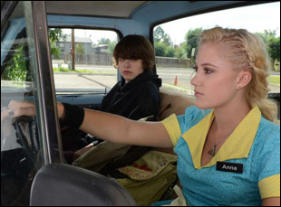 "Brendan Meyer and Maika Monroe in ""The Guest"""