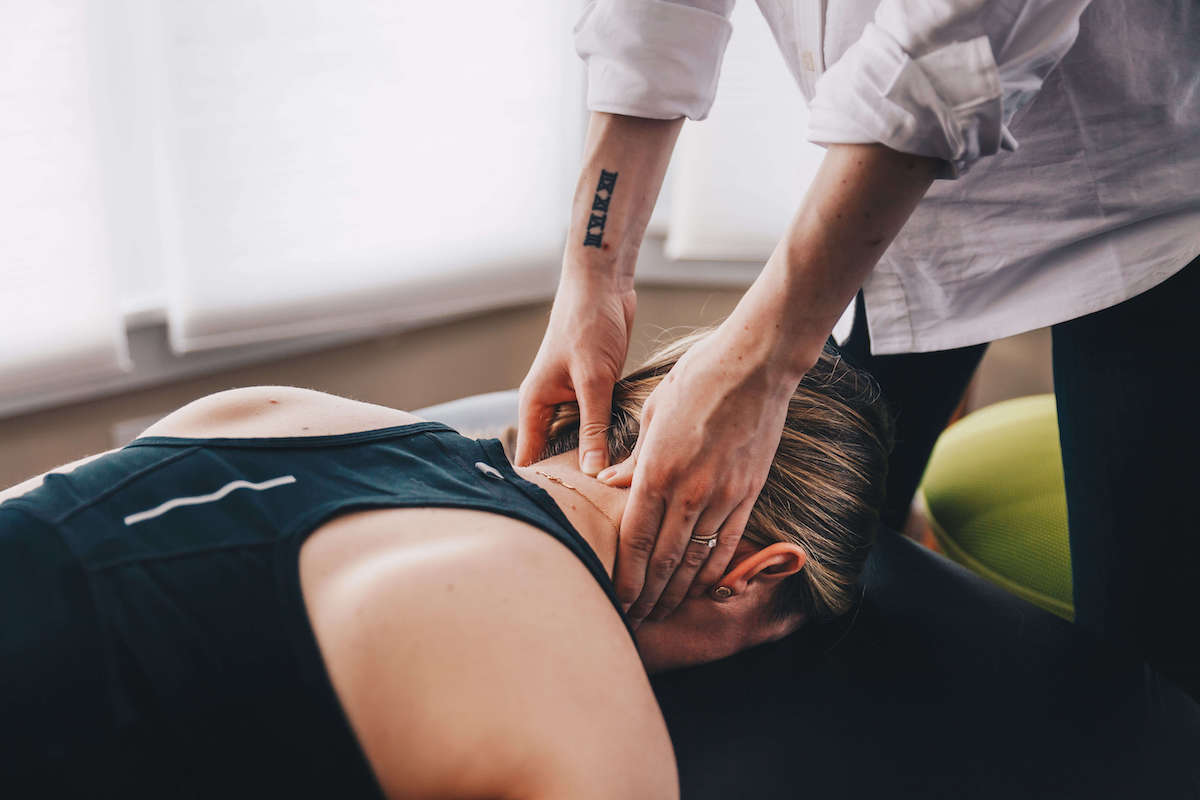 Physical therapist in oregon treating neck pain with hands on therapy