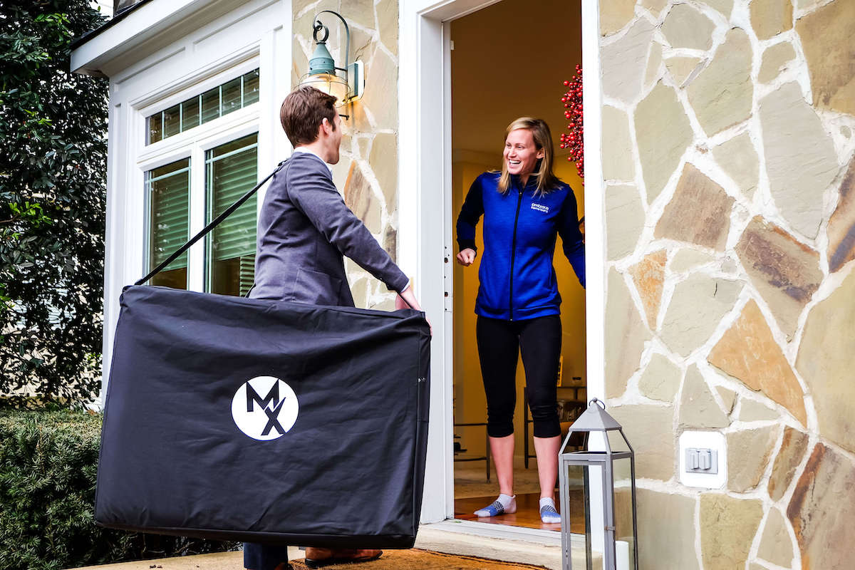 Physical Therapist arriving at home in Arlington Virginia with treatment table in hand