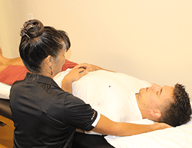 Orleans Physiotherapist applying craniosacral therapy treatment