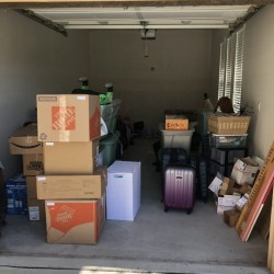 Picture of Movers and Movers helping customer to move out from storage