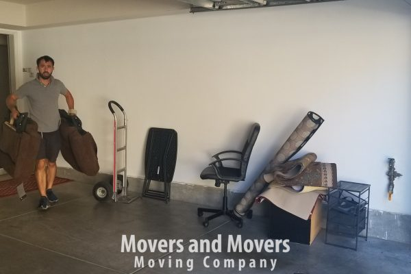 Picture of how Movers and Movers taking a part of costomer's couch and carrying it to the truck
