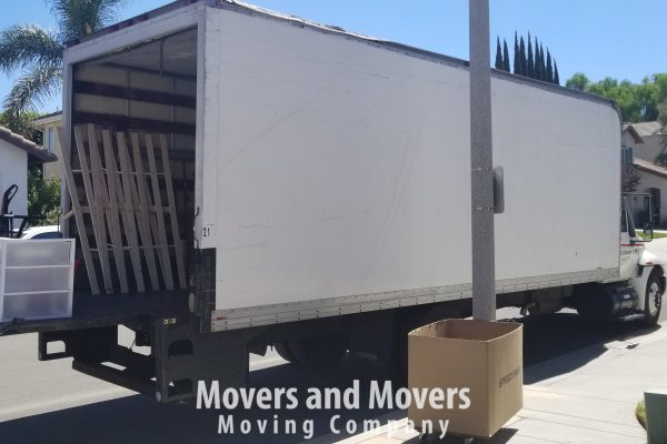 Picture of Movers and Movers unloading 24 ft truck at customer's new location