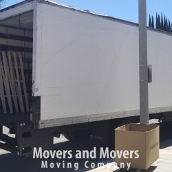 Picture of Movers and Movers unloading 24 ft truck at customer