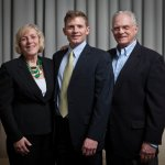 Honoree Jim Harris (center), a traumatic spine injury patient, with parents Mary Pat and Jeff Harris