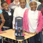 students showcasing their 3D group inventions