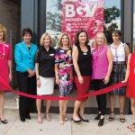 Staff and board members at the ribbon-cutting: MaryAnne Pietromonaco, Kathy Mitts, Janet Schlegel, Cheryl Stamm, Karen Finan, Nancy Aichholz, Michelle Andersen and Angela Ozar