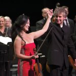 "Violinist Chee-Yun and Christopher Zimmerman take a bow during the ""Rhythmic Strings"" concert. Photo by Phil Groshong"
