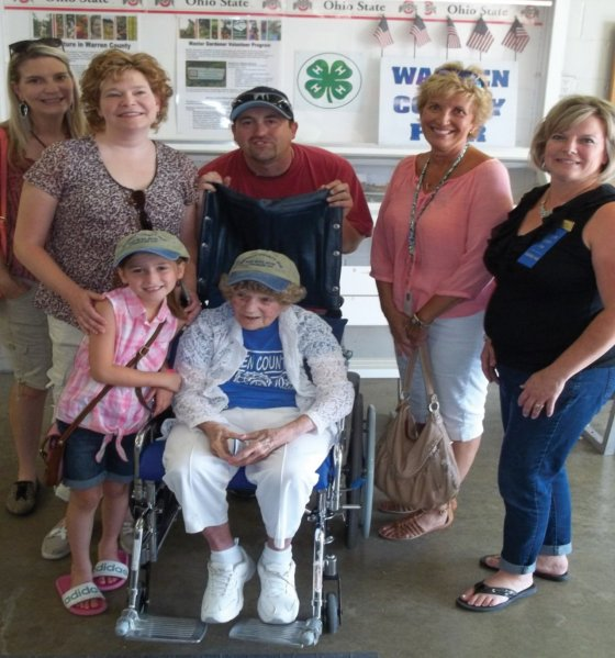 Among those with Hilda Goodman (center) are social worker Maria Fuentes, granddaughter Leslie Rush and her husband, great-granddaughter Emma Rush, Hospice volunteer Anita Patrick and Rebecca Osborne, Warren County Fair secretary and facility manager.