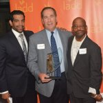 Kush Kotecha; honoree Steve Rohde, president of George H. Rohde & Son Funeral Home; and John Roach