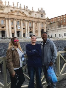 Outside St. Peter Basilica in Rome, Tiffany Hunter; Jeffery Whalen and St.. Vincent de Paul reentry coordinator Dominic Duren