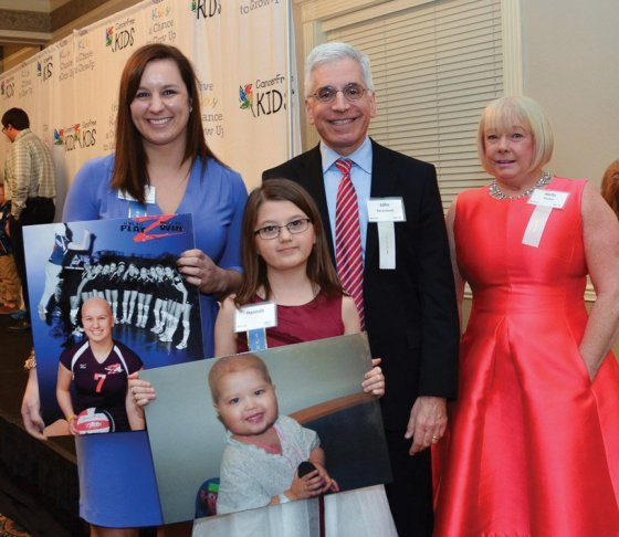 Dr. John Perentesis and Dr. Stella Davies, both of Children's, with pediatric cancer survivors Jenna Pilipovich and Hannah Rumping