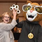 League board president Carol Sanger, celebrating with special guest Scooter the Neutered Cat