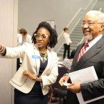 ProKids staff member Raynal Moore guides ProKids board member Dr. James H. Powell