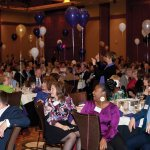 Guests purchase balloons to fund association programs.