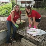 Volunteers from Macy's weeding and cleaning up Five Points Alley