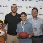 Host Bengals player Tyler Eifert with guests