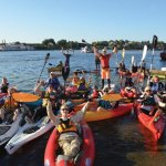 Safety kayakers and stand-up paddle boarders were there to help swimmers, if needed.