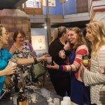 Sara Barnes of Boone County Distilling Company pours bourbon samples.