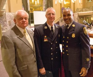 Cincinnati Rotary President Al Koncius with Lt. Joseph Arnold and Chief Roy Winston