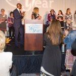 Eddie Tyner, Cincinnati Enquirer president, and Ellen M. Katz, CEO of the Greater Cincinnati Foundation, join honorees onstage.