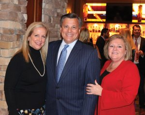Kerry and John Mongelluzzo, Stepping Stones board president, and event chair Patti Zesch