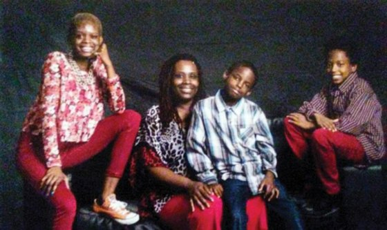 Tameca B., who will own the home, with her daughter Renan (far left) and sons Zabdoul and Zannuel